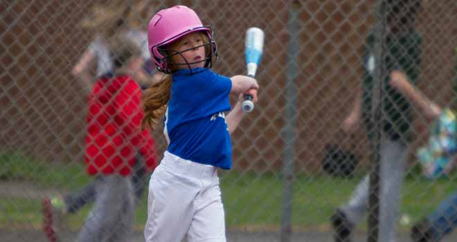 Girl Swinging a Softball Bat